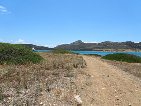 The coast of Antiparos with a view of Despotiko island on the background. In Cyclades, Greece