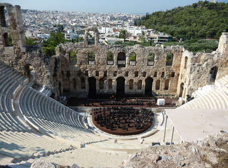 An ancient Greek amphitheatre with the view of Athens in the background, Greece Stock Photo