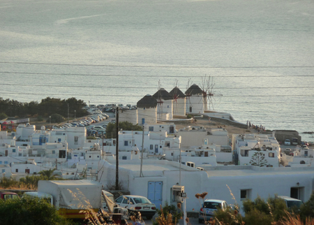 A view of Mykonos with its white mills at sunset, Greece