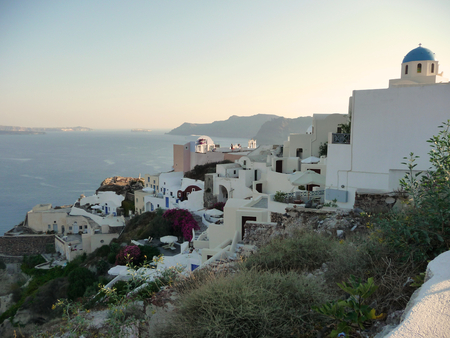 OIA, GREECE, CIRCA JULY 2011: View of the white Oia village, Greece. It is the ancient capital of the Santorini island. Stock Photo
