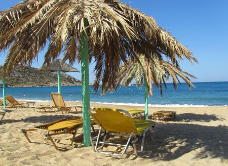 Straw umbrellas in the empty beach