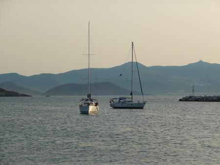 Sailboats at sunset, Greece