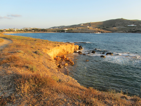 View of seashore in Antiparos island at sunset, Cyclades, Greece Stock Photo
