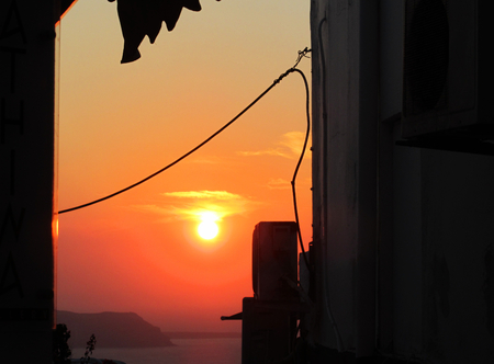 Sunset in a street of Fira town at Santorini island, Cyclades, Greece Stock Photo