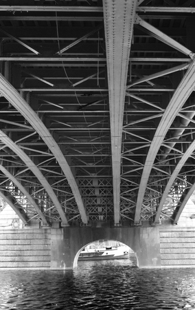 Under a metal bridge on a river. Black and white. Stock Photo - 93864916