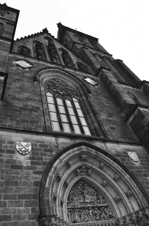 The facade of the Vyšehrad cathedral in Prague in Czech Republic. Black and white. Stock Photo