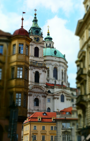 The Church of Saint Nicholas: a Late-Gothic and Baroque cathedral in the Old Town of Prague in Czech Republic. Tilt-shift effect applied. Stock Photo - 93848888