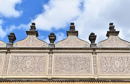 A detail of the ancient Schwarzenberg or Lobkowicz Palace in Prague, in Czech Republic, with blue sky and white clouds. Stock Photo - 93848893