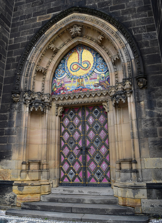 The colorful and decorated main entrance of  the Vyšehrad cathedral in Prague in Czech Republic. Stock Photo