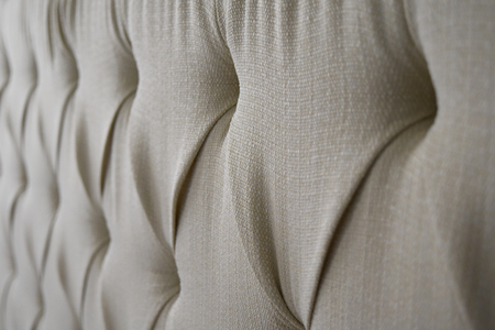 Quilted white headboard suitable to be used like background. Stock Photo