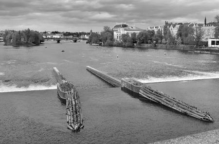The river Vltava in Prague city in Czech Republic. Black and white. Stock Photo - 93848899