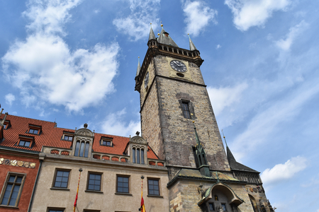 The clock tower of Old Town Hall in Prague in Czech Republic, with blue sky and white clouds in the background.