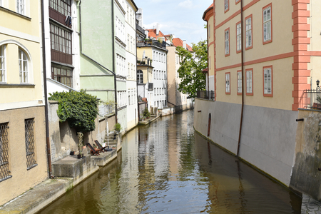 A canal between buildings in Prague in Czech Republic. Stock Photo - 94077955