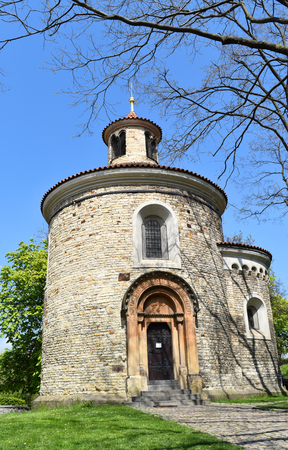 The Rotunda of St. Martin from 11th century near the Vyšehrad fort in Prague in Czech Republic, in a sunny day with blue sky.