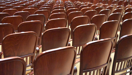Many wooden chairs in a theater. Suitable to be used like a background. Stock Photo - 93848906