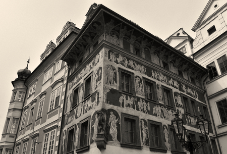 An ancient painted house in Old Town Square in Prague, Czech Republic. Sepia effect. Stock Photo - 93848907