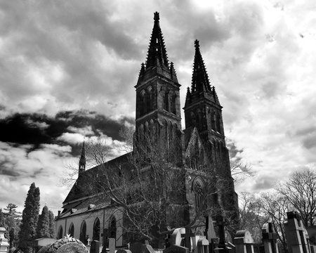 The Vyšehrad cathedral with its ancient cemetery in Prague in Czech Republic. Black and white. Stock Photo