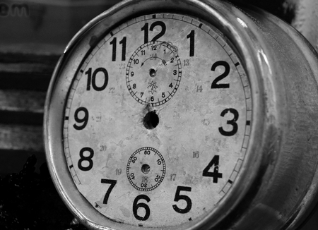 A very old and damaged clock. Black and white. Stock Photo - 94130321