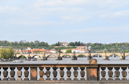 A view of Charles Bridge on the Vltava river in Prague in Czech Republic in a sunny day. Stock Photo - 94116226