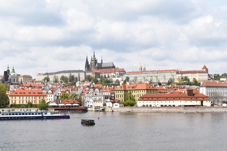 View of the city center and castle of Prague in Czech Republic, seen by the bank of the river Vltava