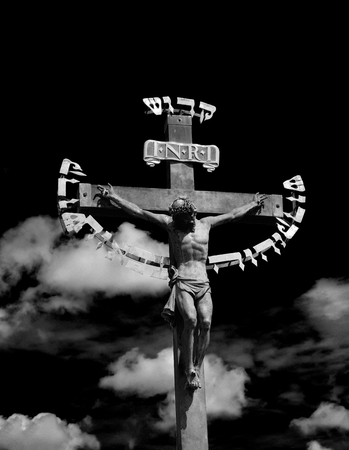 The sculpture of the crucifixion of Jesus with golden decorations: it was the only one decorations on Charles bridge for 200 years. Black and white.