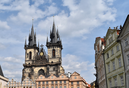 Church of Mother of God before Týn or Church of Our Lady before Týn in the Old Town Square in Prague, Czech Republic, with blue sky and white clouds in the background.