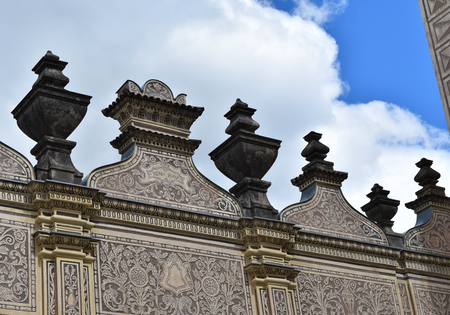 A detail of the ancient Schwarzenberg or Lobkowicz Palace in Prague, in Czech Republic, with blue sky and white clouds. Stock Photo - 94130375