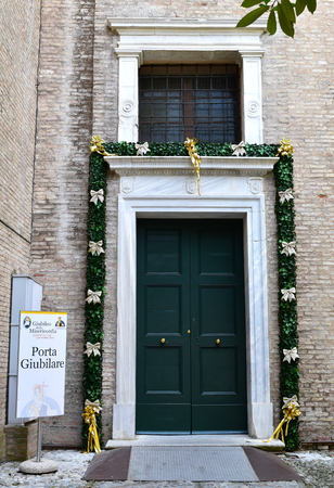 RAVENNA, ITALY, JULY 2016: A Holy Door open for Jubilee year celebrations. Traditionally only Rome had Holy doors but, from 2015, Pope Francis allowed each Roman Catholic diocese in the world to have one or more local Holy Doors Editorial