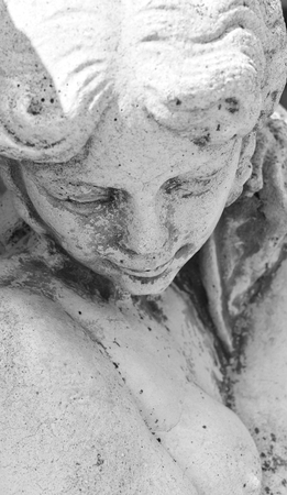 A statue of a young woman with shy expression