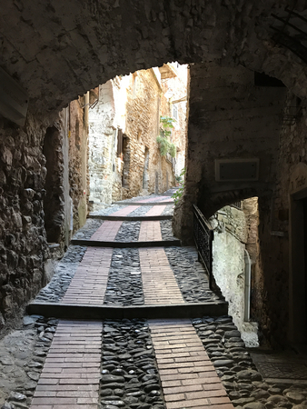 A small stone alley in the Medieval ancient hamlet of Dolceacqua in Italy.