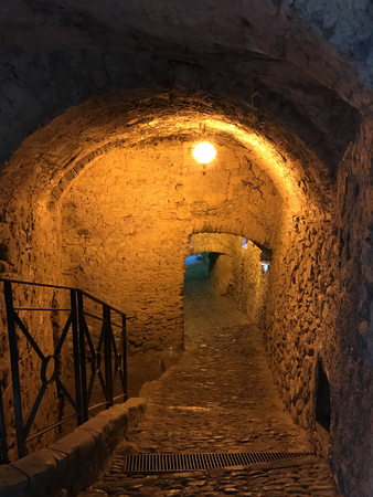 A small alley underground in the Medieval ancient hamlet of Dolceacqua in Italy. Editorial