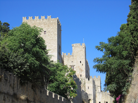 The old castle of Rhodes town with its medieval walls in Dodecanese archipelago in Greece Editorial