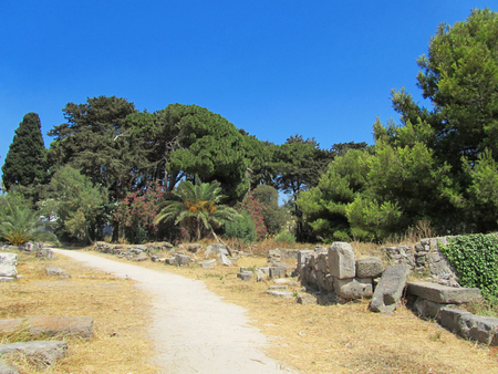 Ancient ruins between trees in a park on Kos island, Greece