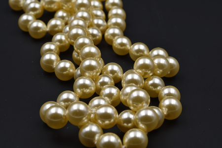 Pearls with black background. Macro.
