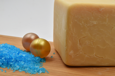 Concept for treatment in a thermal spa: relaxing bath with natural soap, bath salts and a candle.