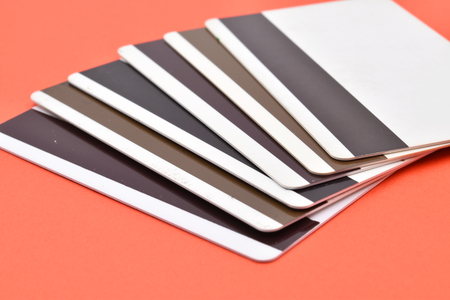 Magnetic cards on red background. Stock Photo