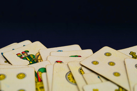 Italian suits playing cards with copy space. Tilt-shift effect applied.