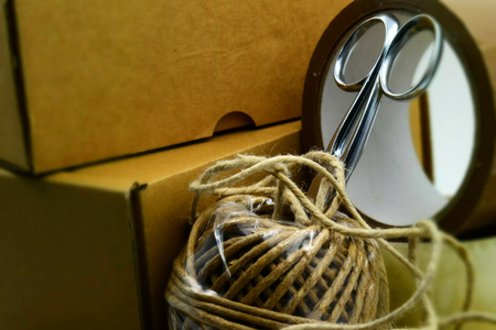 Concept for shipping: box, scissors, rope and adhesive strips. Tilt-shift effect applied.