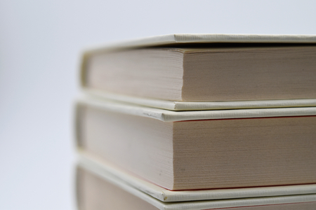 A white books pile. Suitable to be used like a background. Stock Photo
