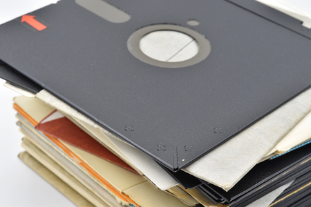 A pile of very old vintage 5¼-inch floppy disk on white background. Stock Photo