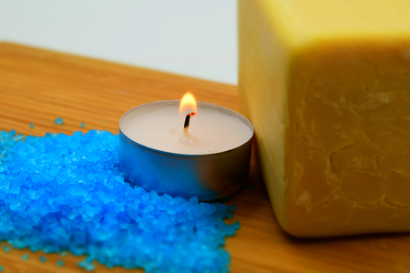 Concept for treatment in a thermal spa: relaxing bath with natural soap, bath salts and a candle. Tilt-shift effect applied.
