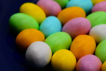 Close up of colorful Easter eggs. Suitable to be used like a background. Tilt-shift effect applied.