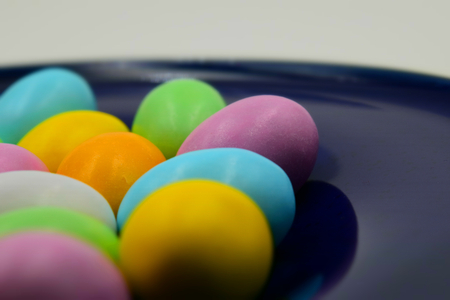 Close up of colorful Easter eggs on a blue disc. Suitable to be used like a background. Stock Photo