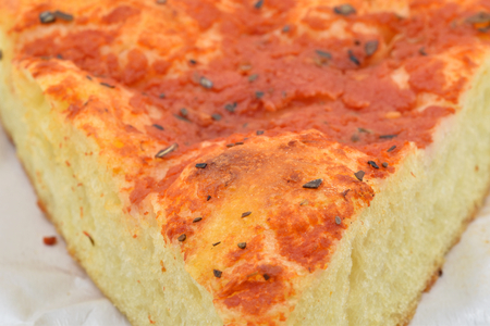 A slice of Italian homemade pizza with tomatoes sauce and oregano, also called ? ?? red focaccia?? : it is typical of North Italy. 写真素材