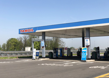 HIGHWAY PIACENZA-TURIN, ITALY, CIRCA APRIL 2018: a gas station or petrol pump attendant for car.