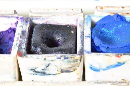 Macro of three watercolor bowls blue, purple and indigo