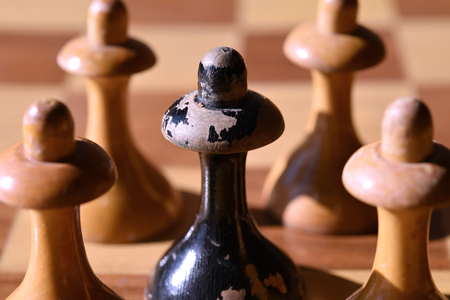 To be different: a black chessman between white chessmen