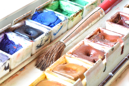 Box of watercolors with a brush