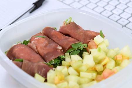 Homemade lunch at work (office): ham roll with bell pepper salad.