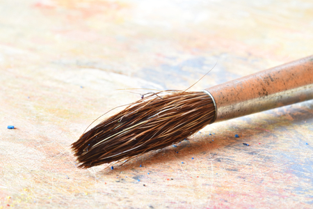 The tip of a paint brush on a palette (macro)